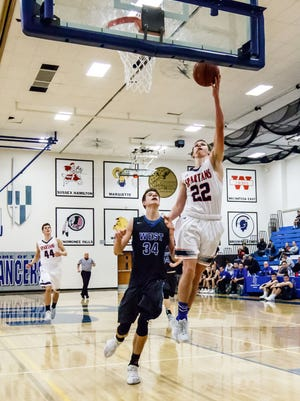 Brookfield East senior Peyton Simon (22) drives in for a layup during the Luke Homan Memorial Showcase game against Oshkosh West at Brookfield Central on Saturday, Jan. 20, 2018.