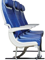 This undated photo provided by Southwest Airline shows a side view of seats on future Southwest planes. The airline announced Tuesday that future planes will have seats that are a bit wider and C-shaped to give passengers in the next row a smidge more knee room.
