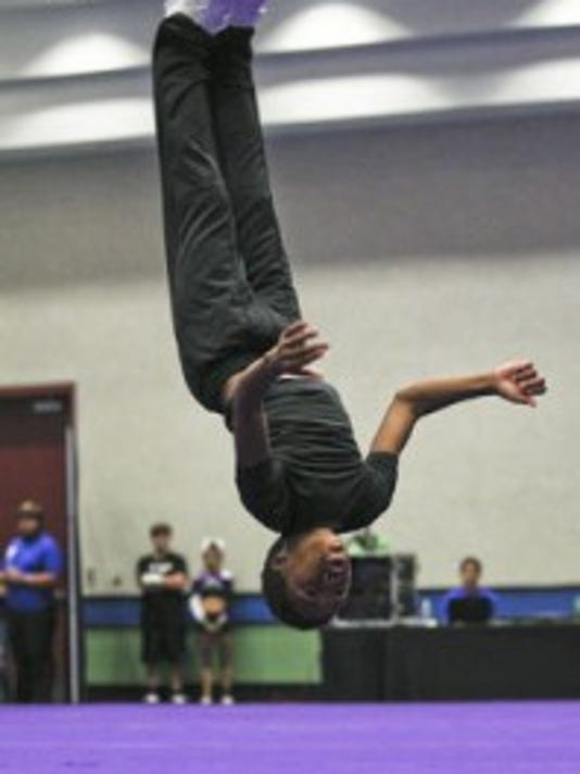 Louisville's Alpha Cheer Allstars Thaddeus Bell, 11, performs somersaults during competition at the America's Best Championships at the Kentucky State Fair Saturday morning. 2013 Courier-Journal file photo by Matt Stone.