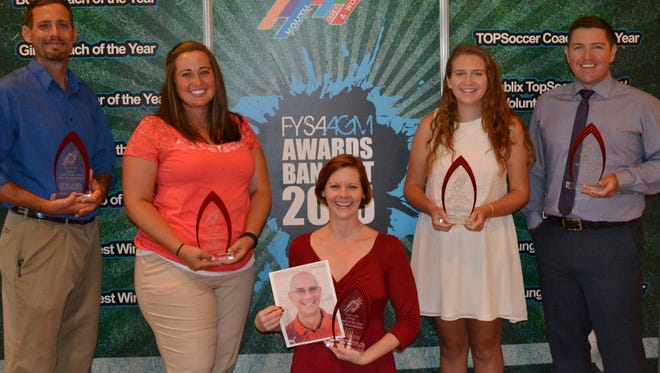 Space Coast United Soccer Club was named the Florida Youth Soccer Association Recreation Club of the Year at the annual awards banquet Saturday at DisneyÕs Buena Vista Palace Hotel. From left are Ben Plechaty, Alyssa Esposito, board member Ann Fuller accepting for Tim Michaud, Kala Neighbor and Rob Dinnie.
