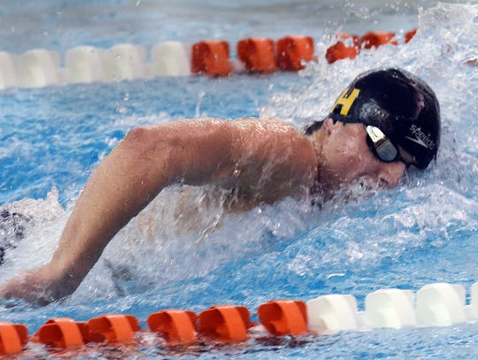 Hartland's Cory Nelligan won the 50 freestyle and 100