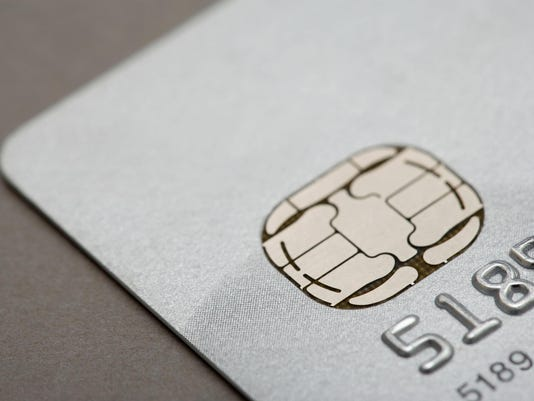 Chip credit cards could slow holiday shopping