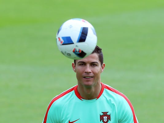 Portugal's Christiano Ronaldo exercises with the ball during a training session in Marcoussis, near Paris, France, Monday, July 4, 2016. Portugal will face Wales in a Euro 2016 semi final soccer match in Lyon on Wednesday, July 6, 2016. (AP Photo/Thibault Camus)