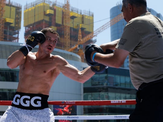"""Boxer Gennady """"GGG"""" Golovkin, left, spars with his coach Abel Sanchez at an open-to-the-public media workout at L.A. LIVE in Los Angeles on Monday, Aug. 28, 2017. Canelo Alvarez vs. Gennady """"GGG"""" Golovkin is a 12-round box fight for the middleweight championship of the world presented by Golden Boy Promotions and GGG Promotions. The event will take place Saturday, Sept. 16, 2017, at T-Mobile Arena in Las Vegas. (AP Photo/Damian Dovarganes)"""
