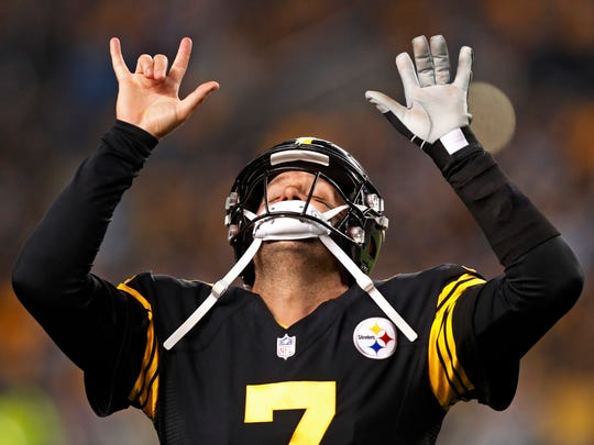 Pittsburgh Steelers quarterback Ben Roethlisberger (7) celebrates a touchdown pass to Antonio Brown during the first half of an NFL football game against the Carolina Panthers in Pittsburgh, Thursday, Nov. 8, 2018. (AP Photo/Keith Srakocic)