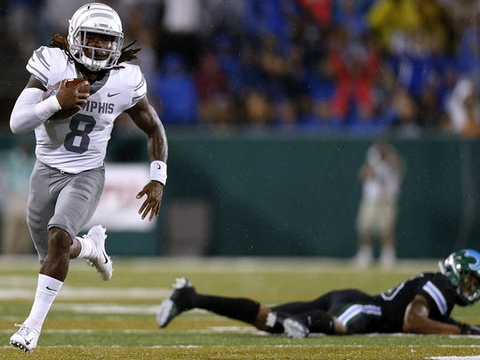 NEW ORLEANS, LA - SEPTEMBER 28:  Darrell Henderson #8 of the Memphis Tigers runs with the ball for a touchdown as Thakarius Keyes #26 of the Tulane Green Wave defends during the first half at Yulman Stadium on September 28, 2018 in New Orleans, Louisiana.  (Photo by Jonathan Bachman/Getty Images)