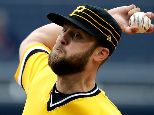 Pittsburgh Pirates starting pitcher Jordan Lyles delivers during the first inning of a baseball game against the Oakland Athletics in Pittsburgh, Sunday, May 5, 2019.  (AP Photo/Gene J. Puskar)