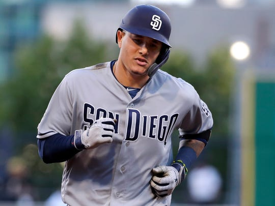San Diego Padres' Manny Machado rounds third base after hitting a solo home run off Pittsburgh Pirates starting pitcher Joe Musgrove during the fourth inning of the team's baseball game in Pittsburgh, Friday, June 21, 2019. (AP Photo/Gene J. Puskar)