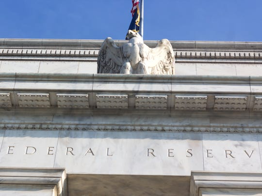 Exterior of the Federal Reserve building with the sculpture of an eagle perched over a doorway.