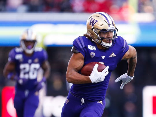 Nov 2, 2019; Seattle, WA, USA; Washington Huskies tight end Hunter Bryant (1) races up the sidelines on his way to a 40-yard touchdown against the Utah Utes during the third quarter at Husky Stadium. Mandatory Credit: Jennifer Buchanan-USA TODAY Sports