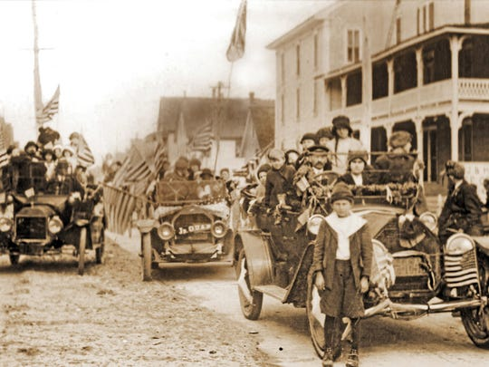 There were plenty of flags being waved when visitors and residents of Ocean City took part in the annual George Washington Birthday Parade on Baltimore Avenue in 1916. Note the number of passengers in each car.