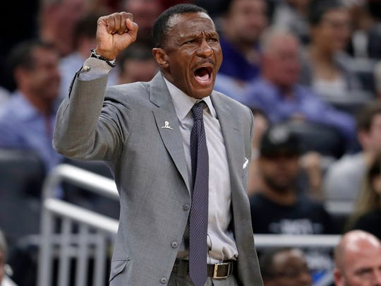 Ex-Toronto Raptors head coach Dwane Casey directs players in a Feb. game against the Orlando Magic. The Pistons hired Casey as head coach.