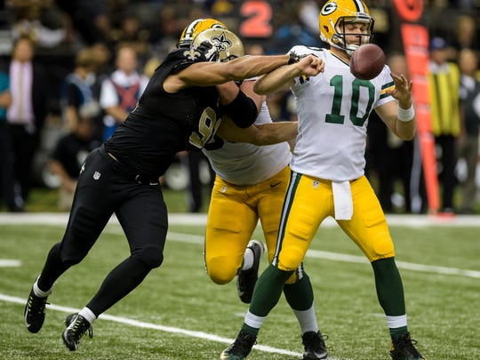 New Orleans Saints outside linebacker Kasim Edebali (91) sacks and forces a fumble from Green Bay Packers quarterback Matt Flynn (10) during the second half of an NFL football game at the Mercedes-Benz Superdome in New Orleans, La., Sunday, Oct. 26, 2014.  Paul Kieu, The Advertiser