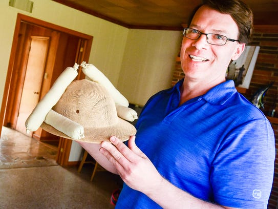 Bob Carriker shows off his boudin hat at his home in