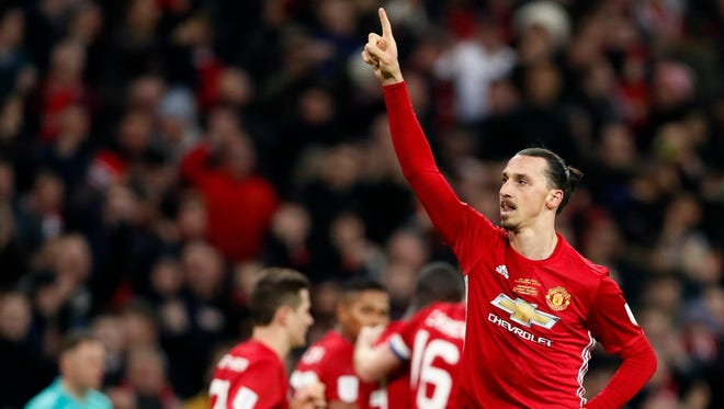 United's Zlatan Ibrahimovic celebrates after scoring his side's third goal during the English League Cup final soccer match between Manchester United and Southampton FC at Wembley stadium in London.