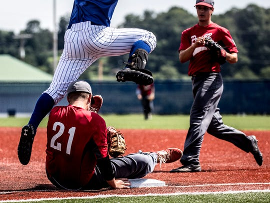 Jacob Heckman of Utica Post 92 rolls onto first base to take out a player from Steubenville. Utica lost to Steubenville in the opening round of the American Legion state tournament 8-0.