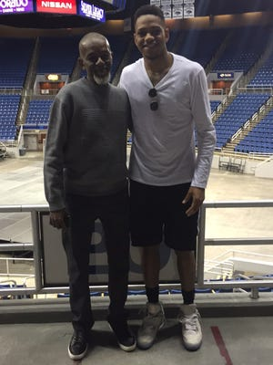 Hallice Cooke, right, and his dad Robert during Hallice's official visit at Nevada in the summer of 2016. Robert Cooke died last June after fighting lung cancer.