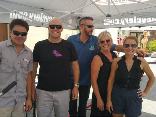 From left to  right, Chris Cross, David Herlinger, Brett Klein, Ava Kyle and Michele Mician participate in a bike giveaway for desert youths in 2015.