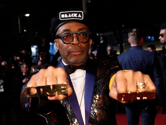 Spike Lee leaves the screening of 'BlacKkKlansman'