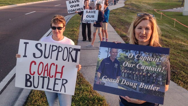 Close to 100 people gathered at the entrance to Holy Trinity Episcopal Academy on Monday.