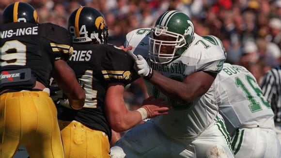 Flozell Adams, here blocking Iowa's Jared DeVries, was an All-American left tackle in 1997.