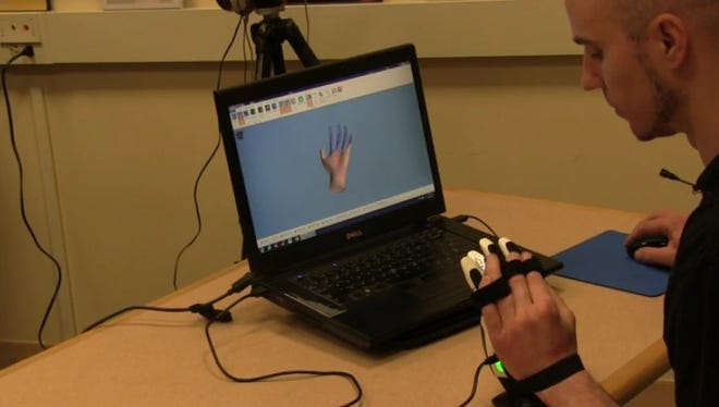 A user demos new video game-like technology which would stand to help survivors of stroke and traumatic brain injury regain mobility.