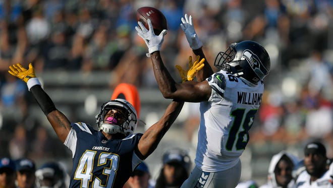 Seattle Seahawks wide receiver Kasen Williams (18) makes a catch against the Chargers during the preseason. Seattle waived Williams during Saturday's roster cuts.