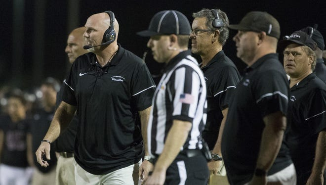 Hamilton's head coach Steve Belles looks to the field during a game against Skyline at Hamilton High School on September 23, 2016 in Chandler.