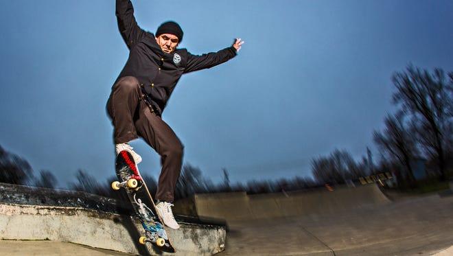 Kevin Jones, owner of Subsect Skateshop, skates at the four mile community center.