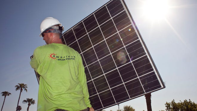 The solar industry in Arizona is slowing down as regulators grapple with how much of a premium customers should pay to use renewable power and whether it is fair for non solar customers to pay most of the expense of maintaining the power grid. (Photo by Mark Henle/ The Arizona Republic