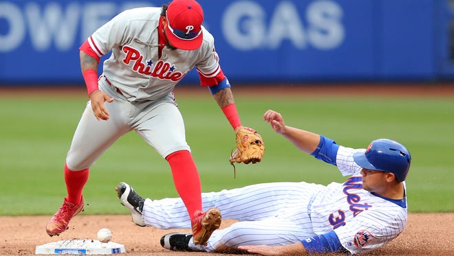 Mets left fielder Michael Conforto is safe at second after Phillies shortstop Freddy Galvis drops the throw during the second inning at Citi Field on Friday.