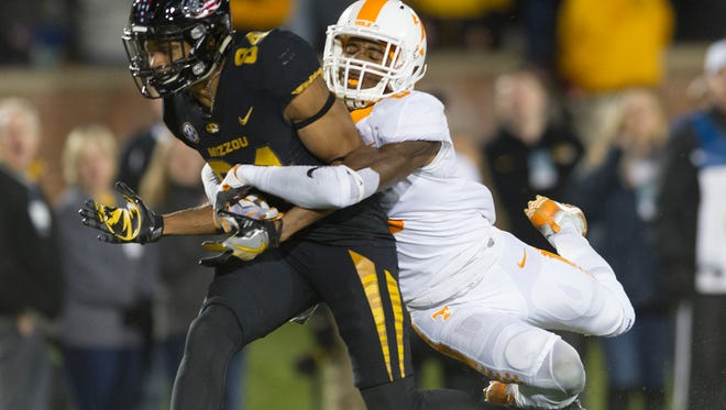 Tennessee defensive back Justin Martin (8) tackles Missouri wide receiver Emanuel Hall (84) during a game between Tennessee and Missouri at Faurot Field in Columbia, Missouri, on Saturday November 11, 2017.