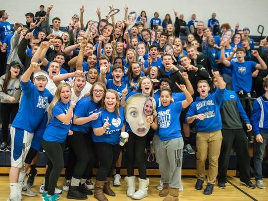Harper Creek students cheer their team on during regional