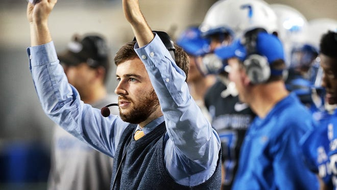 Commercial Appeal sports writer Tom Schad reacts after the Tigers score under his leadership (sort of) during the University of Memphis annual spring scrimmage at the Liberty Bowl Friday Night.