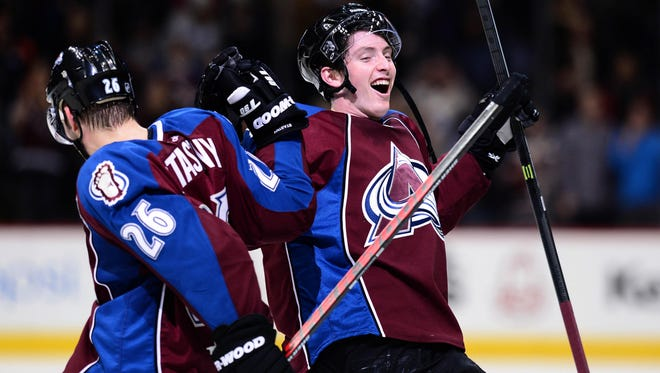 Colorado Avalanche center Matt Duchene (9) and center Paul Stastny (26) react to a win against the Calgary Flames.