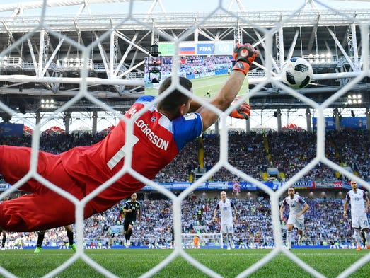 Iceland goalkeeper Hannes Halldorsson saves a penalty