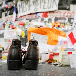 A pair of shoes in front of the Memorial on Place de la Republique, Paris, France on November 30, 2015, the day after clashes between demonstrators and French riot police ahead of the COP21 World Climate Change Conference 2015 in Paris.