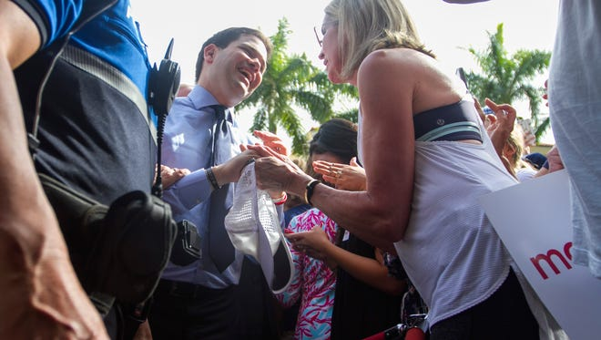 Republican Presidential candidate Marco Rubio greets supporters at Yabba Island Grill in Naples on Friday, March 11, 2016.