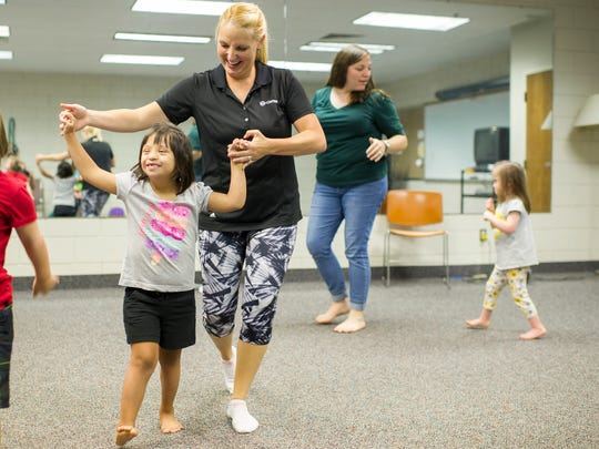 Dahlia Petigjen, 7, of Evansville, dances with instructor Natalie Rascher, also of Evansville, during SMILE on Down Syndrome's summer dance class at  the Deaconess Health Science Building in Evansville, Wednesday, Aug. 10, 2016. Dancers are preparing for their Summer recital which takes place Wednesday at Johnson Hall in the Deaconess Health Science Building.