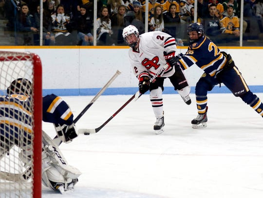 SPASH player Carter Smigaj makes an attempt at a goal,