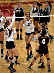Ankeny's Moriah Johnson (15) celebrates with teammates