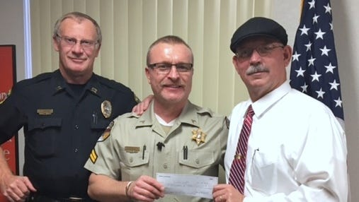 Pictured from left to right, APD Capt. Tim Keelin, Otero County Sheriff's Office Cpl. and Crime Stoppers Director Theo Livingston and APD Deputy Chief Roger Schoolcraft.