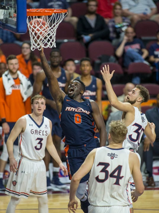 Pepperdine's Amadi Udenyi (0) slices through the St. Mary's defense for a basket during the second half of an NCAA college basketball game in the quarterfinals of the West Coast Conference tournament, Saturday, March 3, 2018, in Las Vegas. (AP Photo/L.E. Baskow)