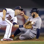 Detroit Tigers left fielder Tyler Collins (18) steals second base before Minnesota Twins second baseman Brian Dozier (2) can catch the ball to make a tag in the sixth inning Tuesday at Target Field in Minneapolis.