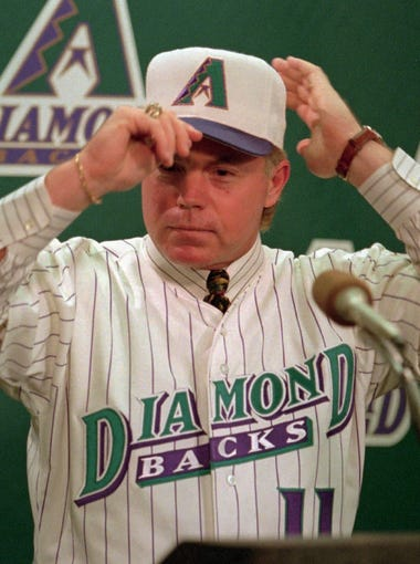 Former New York Yankees manager Buck Showalter tries on his new uniform during a news conference in Phoenix Wednesday Nov. 15, 1995  where he was named the first manager of the Arizona Diamondbacks expansion baseball team.