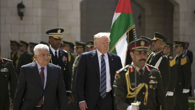 President Trump and Palestinian President Mahmoud Abbas review an honor guard in the West Bank city of Bethlehem Tuesday.