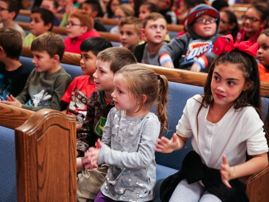 More than 350 students listen to a show during the