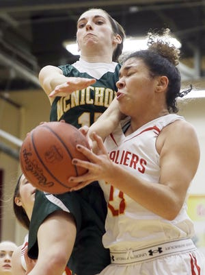McNicholas guard Morgan Vogler battles Purcell Marian's Kyndal Wilson for a rebound Wednesday night.