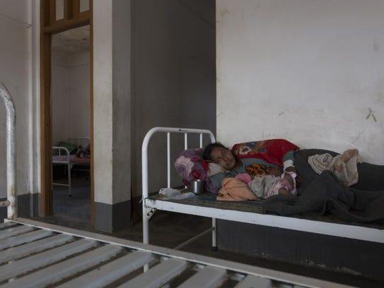 Amina waits in the Thet Kay Pyin clinic.