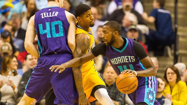 Charlotte Hornets forward Michael Kidd-Gilchrist (14) dribbles the ball while Indiana Pacers forward Paul George (13) defends in the first half of the game at Bankers Life Fieldhouse.